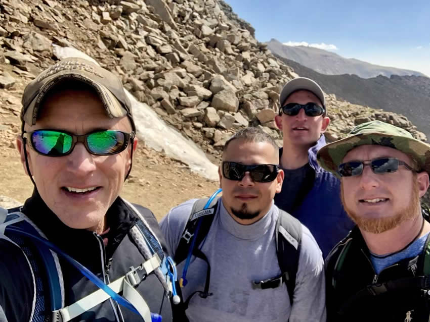 Integrity Roofing & Painting hiking in Colorado